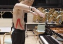 A dancer controls a piano by his movements.