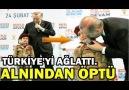 Erdoğan Bordo bereli küçük kızı sahneye çağırarak Alnından öptü
