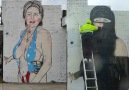 Graffiti artist turns Hillary Clinton into a Muslim