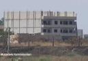 IŞİD'li militanlar Türkiye sınırını gözetliyor...