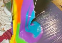 Justin Flom - ARTIST USES SWINGING BUCKET OF PAINT ON SPINNING CANVAS Facebook