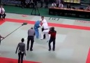 Karate referee gets into the fight