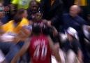LeBron James falls into Shaq's lap !