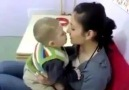 little boy want to kiss a girl . :)