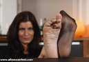 Nelly poses her nylon and bare soles