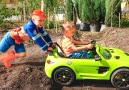 Nikita ride on childrens car and stuck in the ground Vlad tows on the tractor