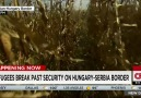Refugees break past security on Hungary border