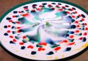 Science helps this tray of milk turn into a magical work of art.