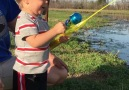 This little boy catches fish with toy rod. What were the odds - via JukinMedia