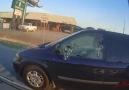 Van throws bottle at biker biker brakes window with a rock