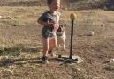 2-year-old swings the bat